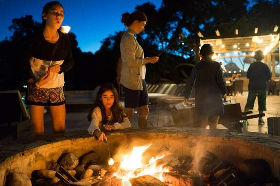 Annabelle Schlikman, left, makes a s'more at Carmel Valley Ranch in Carmel, Calif. on Saturday, Aug. 29, 2015. The Carmel Valley Ranch features around 500 acres of land for activities such as golf, horseback riding and dining.