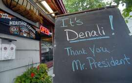A sign is seen at a coffee shop on August 31, 2015  across the street from the Denaina Convention Center, in Anchorage, Alaska where US president Barack Obama will deliver a speech. President Barack Obama will attend a glacier conference to deliver a speech designed to dramatically underscore the impact of global warming on the enviroment. While visiting Alaska, President Obama will also meet native leaders -- after announcing a decision to rename Mount McKinley, the tallest mountain in North America with local name Denali. The mountain had been named in 1896 for a future US president, William McKinley, but local authorities had worked on the change for years, restoring an Alaska Native name with deep cultural significance. AFP PHOTO /JEROME CARTILLIER JEROME CARTILLIER/AFP/Getty Images