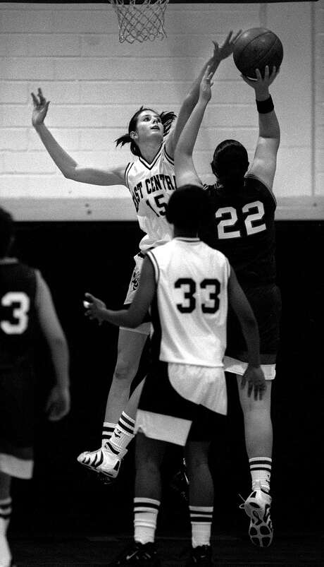 The girls basketball team of East Central High School was the first girls team in San Antonio to make it to a state champtionship game — in 1959, long before Title IX made girls' student sports endeavors expected and accessible. The law had changed everything by 1997, when Robin Burkhart, East Central's #15, went up to block a shot. Photo: Express-News File Photo / SAN ANTONIO EXPRESS-NEWS