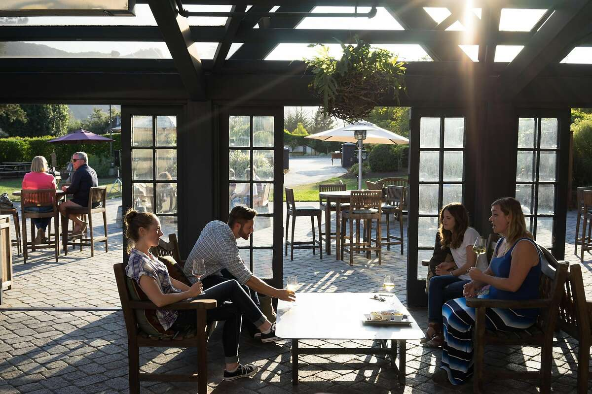 Left to right, Kaylin Berkheimer, Kyle Yedlicka, Kacy Wyman and Samantha Schroeder sample wine at Folktale Winery in Carmel, Calif. on Sunday, Aug. 30, 2015. The winery features a new outdoor pavilion for guests to enjoy.