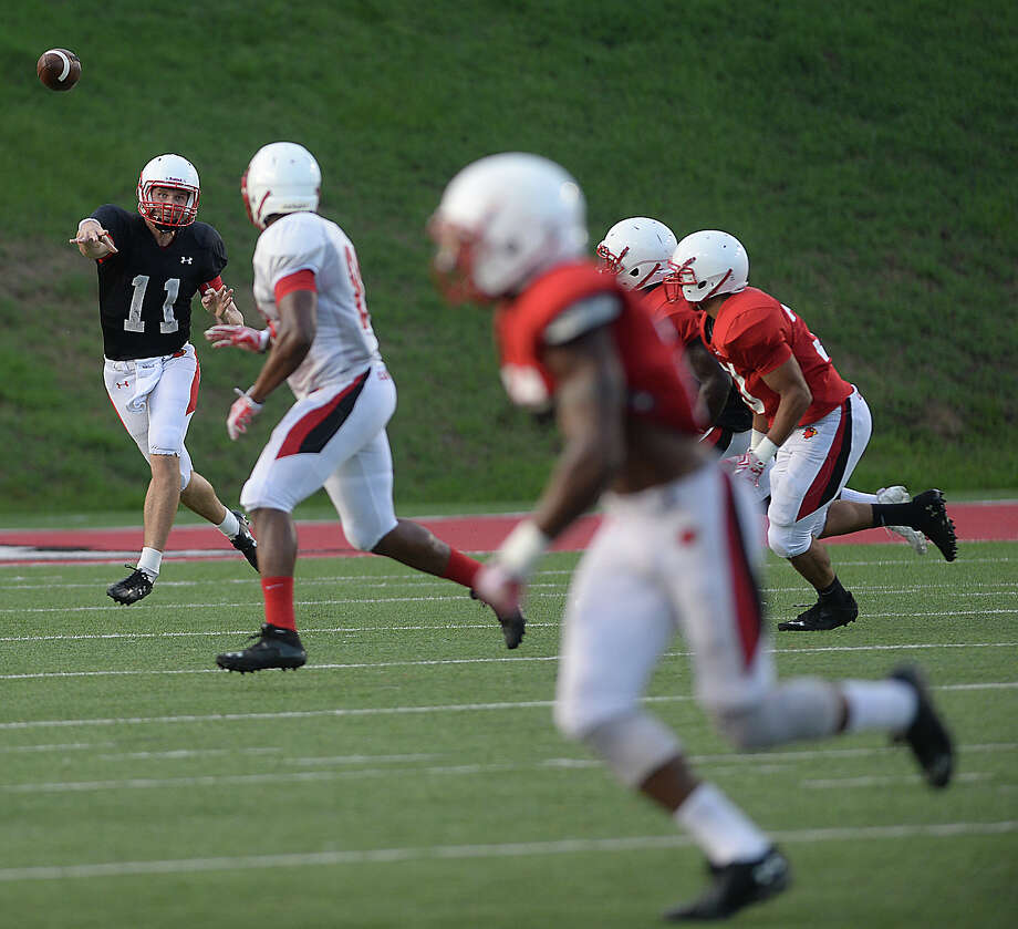Quarterback Carson Earp fires off a pass to an open receiver as the offense and defense square off during Lamar University's kick-off scrimmage at Provost Umphrey Stadium Saturday.  Photo taken Saturday, August 22, 2015 Kim Brent/The Enterprise Photo: Kim Brent / Beaumont Enterprise