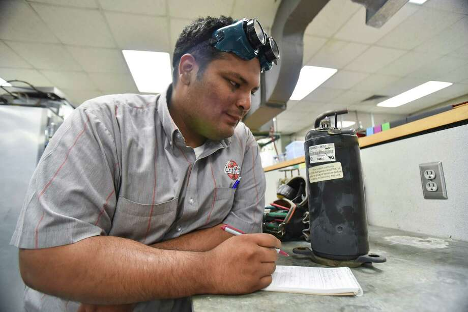 With training and a HVACR technical certifi cate from San Jacinto College, Carlos Amaya found a rewarding career as a refrigeration technician.