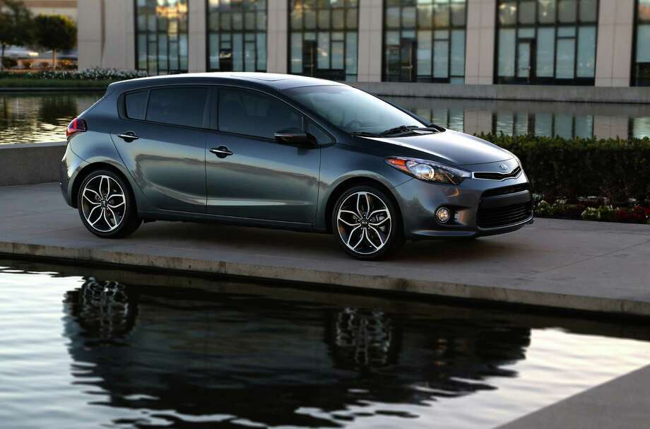 The crisply styled Forte5 SX comes with standard 225/40R18 tires on 7.5-inch wide alloy wheels, up-sized front brakes, an aggressive front fascia and alloy sport pedals. Photo: Kia
