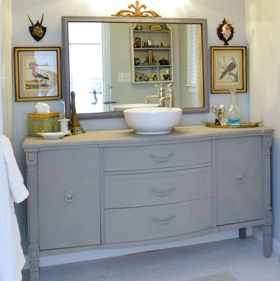 Look for items that are well made. If a piece is solid wood and feels sturdy, you have a winner. This repurposed buffet serves as a vanity in a New Braunfels home. Photo: Chronicle File / San Antonio Express-News