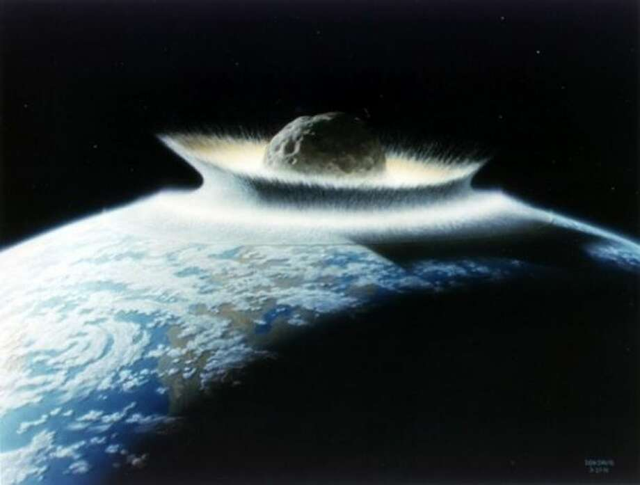 Artist's concept of a catastrophic asteroid impact with the early Earth. Photo: NASA/Don Davis