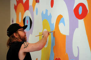 "JoyRide mural captures ""passion"" of indoor cycling - Photo"