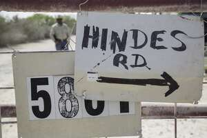 A hand-painted sign on the disputed gate on Hindes Road in northeast La Salle County, Tuesday, September 23, 2014.
