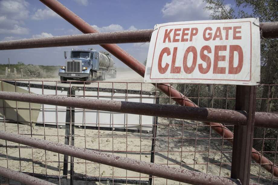 A tanker truck approaches the disputed gate on Hindes Road in northeast La Salle County, Tuesday, September 23, 2014. Photo: For The Houston Chronicle