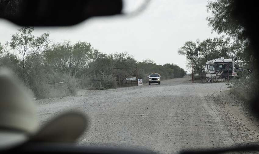 Driving down Hindes Road in northeast La Salle County, Sheriff's Investigator Mike Bostwick approaches the disputed gate, Tuesday, September 23, 2014.