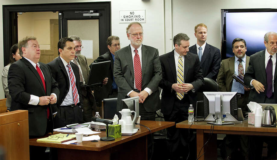 Fifteen lawyers representing six different plaintiff groups crowded one side of the Travis County courtroom of state District Judge John Dietz on Oct. 22, 2012 in Austin, Texas to launch the school finance trial involving about two-thirds of Texas school districts. The case is set for a hearing before the Texas Supreme Court on Tuesday. Photo: Ralph Barrera /Associated Press / American-Statesman