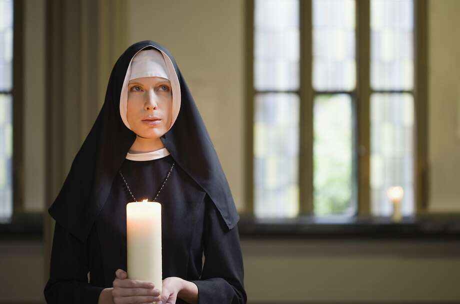 A woman wonder's why her lesbian friend has decided to become a nun. Photo: Turbo/Corbis, Getty Images/Fuse