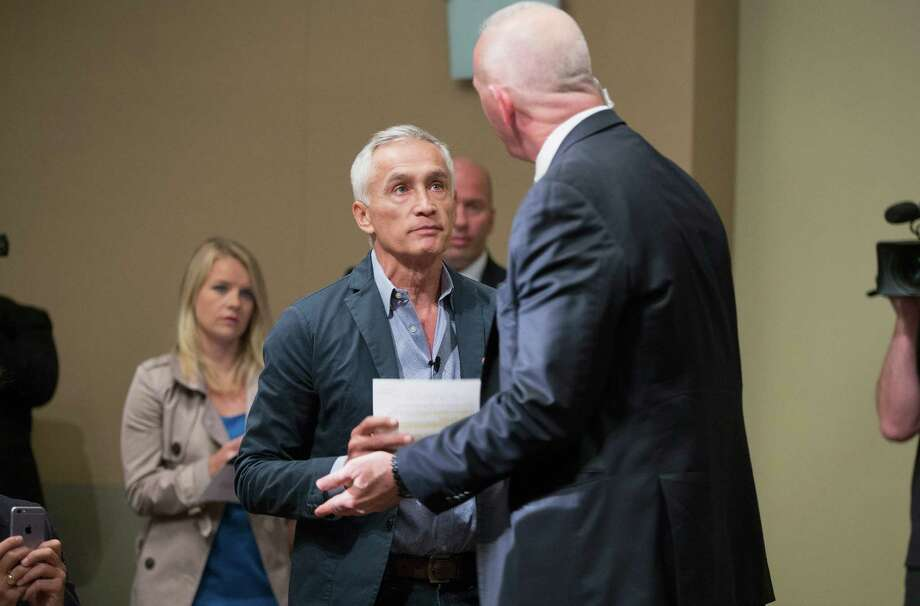 A security staff member for Republican presidential candidate Donald Trump removes Univision and Fusion anchor Jorge Ramos from a press conference after a heated exchange between the journalist and the politician. Photo: Scott Olson /Getty Images / 2015 Getty Images