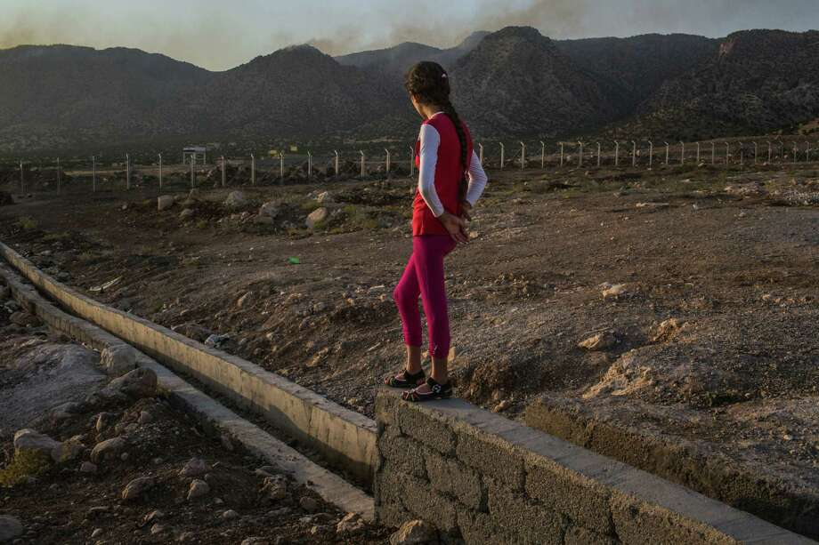 A 12-year-old girl from the Yazidi minority who says she was raped by an Islamic State fighter is now at a refugee camp with her family in Iraq. Sex slavery has been condoned and systematically encouraged by ISIS, a moral and political threat that has been underestimated. Photo: Mauricio Lima /New York Times / NYTNS