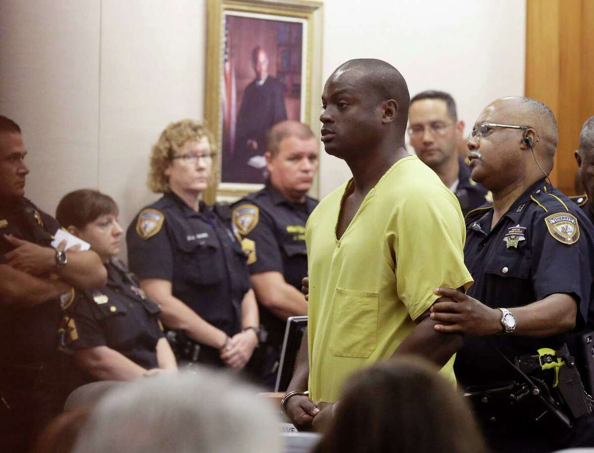 Shannon Miles is escorted out of a courtroom after a hearing Monday, Aug. 31, 2015, in Houston. Miles has been charged with capital murder in the death of Harris County Sheriff's Deputy Darren Goforth. He is being held without bond. (AP Photo/Pat Sullivan)