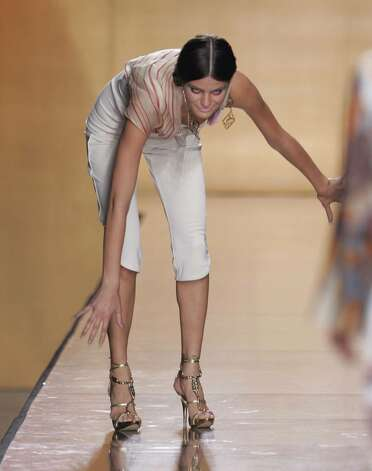 NEW YORK - SEPTEMBER 11:   A model falls on the runway at the Baby Phat Spring 2005 fashion show held at Sky Light Gallery during the Olympus Fashion Week Spring 2005, September 11, 2004 in New York City. (Photo by Carlo Allegri/Getty Images) Photo: Carlo Allegri, Getty Images / 2004 Getty Images