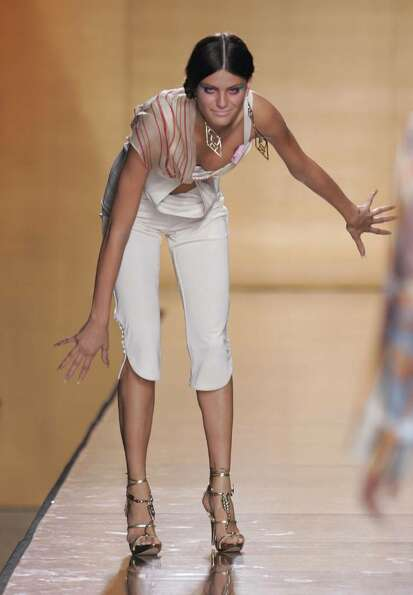 NEW YORK - SEPTEMBER 11:   A model falls on the runway at the Baby Phat Spring 2005 fashion show
