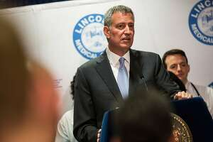 Names & Faces: Urban Meyer, Bill de Blasio - Photo