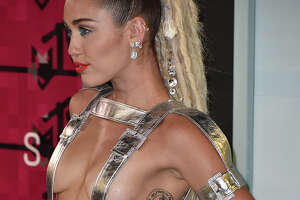Photos: Did Miley host the most naked VMAs ever? - Photo