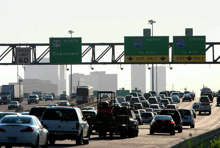 Traffic moves slowly along U.S. 59 near the Westpark Tollway on Aug. 28, 2013, in Houston. Mobile sources, such as vehicles, are the biggest sources of NOx emissions in the nation.  Photo: Cody Duty, Staff / © 2013 Houston Chronicle