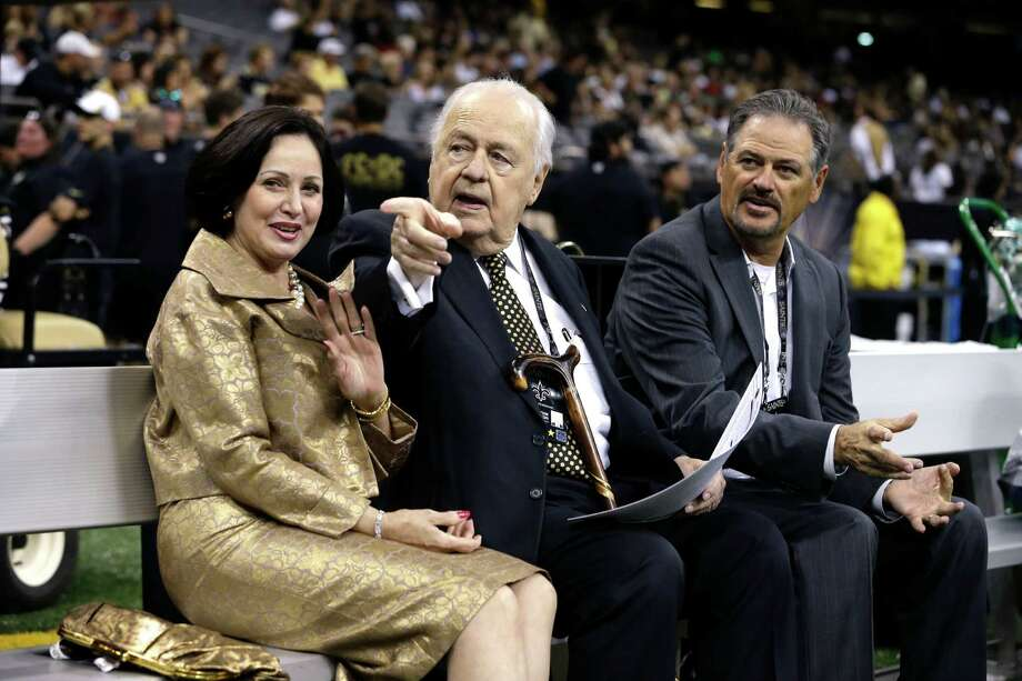 New Orleans Saints owner Tom Benson sits with his wife, Gayle Benson, and general manager Mickey Loomis before Sunday's preseason football game between the Houston Texans and home team New Orleans Saints. Tom Benson has proposed increasing the amount of promissory notes to replace nonvoting shares in the teams held in trust funds. Photo: Jonathan Bachman /Associated Press / FR170615 AP