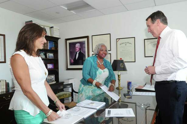 At right, Stanley Twardy, Jr., a partner for the law firm, Day Pitney LLP, conferences with Marianne Summers, left, and Robin Cannon, legal administrative assistants, at the firm's Stamford office at One Canterbury Green in Stamford, Conn., Thursday, July 16, 2015.