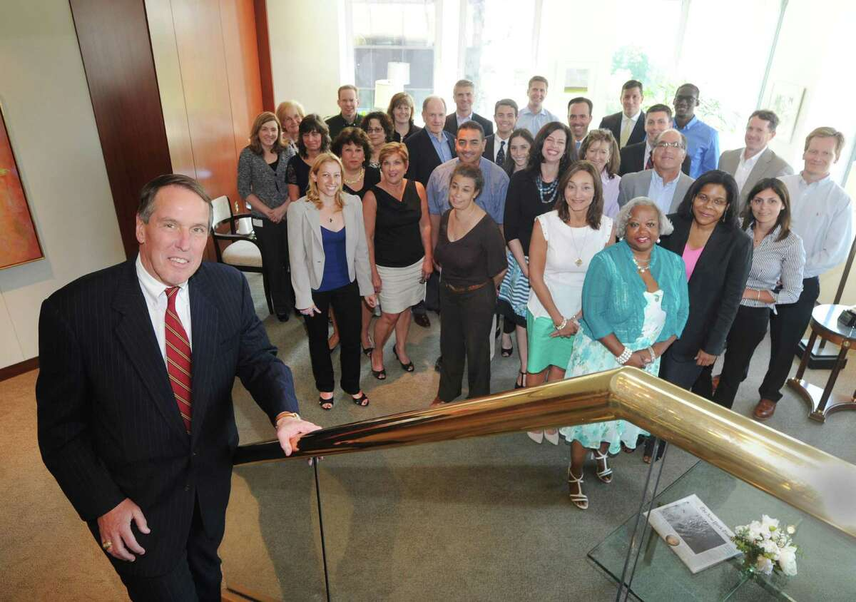 At left, Stanley Twardy, Jr., a partner for the law firm, Day Pitney LLP, with members of his firm in their Stamford office at One Canterbury Green in Stamford, Conn., Thursday, July 16, 2015.