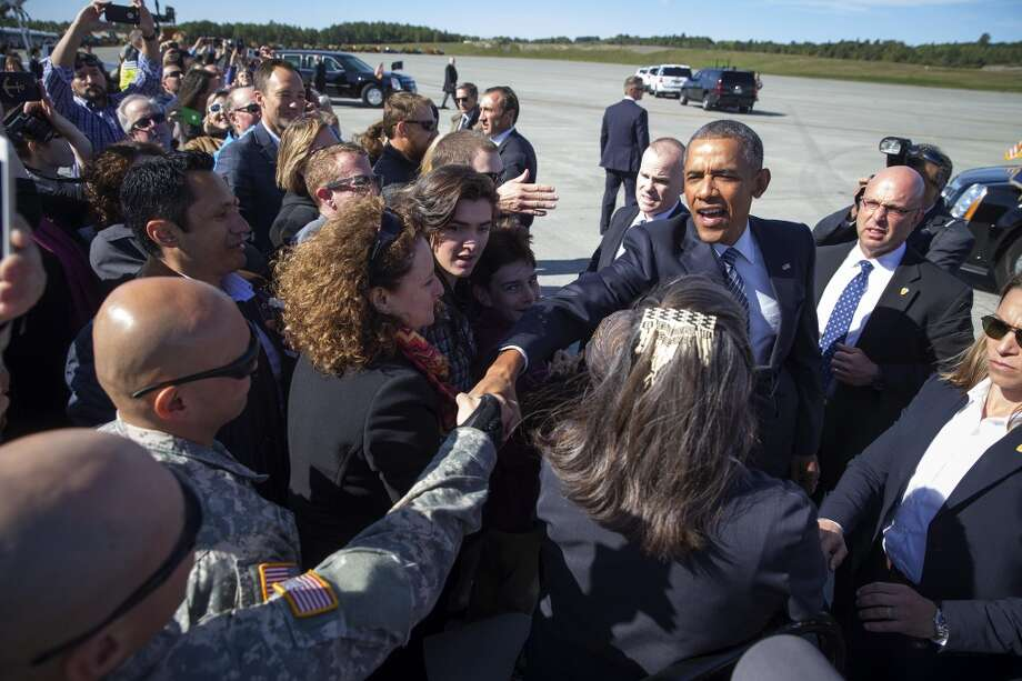 President Barack Obama greets supporters as he arrives at Elmendorf Air Force Base in Anchorage, Alaska, Aug, 31, 2015. Obama traveled to Alaska on the first presidential visit above the Arctic Circle to call for aggressive action to tackle climate change and to participate in a roundtable with Alaska Natives. (Doug Mills/The New York Times) Photo: New York Times