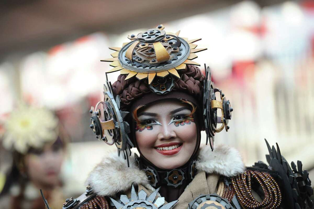 A model wears Circle outfit as part of Art Wear Carnival during 14th Jember Fashion Carnival on August 28, 2015 in Jember, Indonesia. The 14th Jember Fashion Carnival 2015 theme is Outframe and consist of ten parades which include Majapahit, Ikebana, Fossil, Parrot, Circle, Pegasus, Lionfish, Egypt, Melanesia, and Reog. This street carnival is claimed to be one of the biggest in the world and comprises more than 1000 performers parading along 3.6 km of road used as the catwalk.