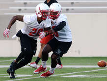 Lamar's Rodney Randle, No. 20, runs through drills with teammate Gratian Gladney, No. 6, on Friday. The Lamar Cardinals held their opening practice Friday evening at Provost Umphrey Stadium. Photo taken Friday 8/7/15 Jake Daniels/The Enterprise   Manditory Credit, No Sales, Mags Out, TV OUT, Web: AP Members Only