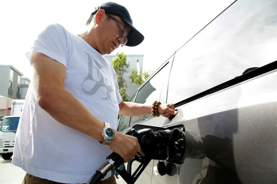 In Texas, Labor Day weekend gas prices will be almost $1 less per gallon than last year. Photo: Connor Radnovich /San Francisco Chronicle / ONLINE_YES