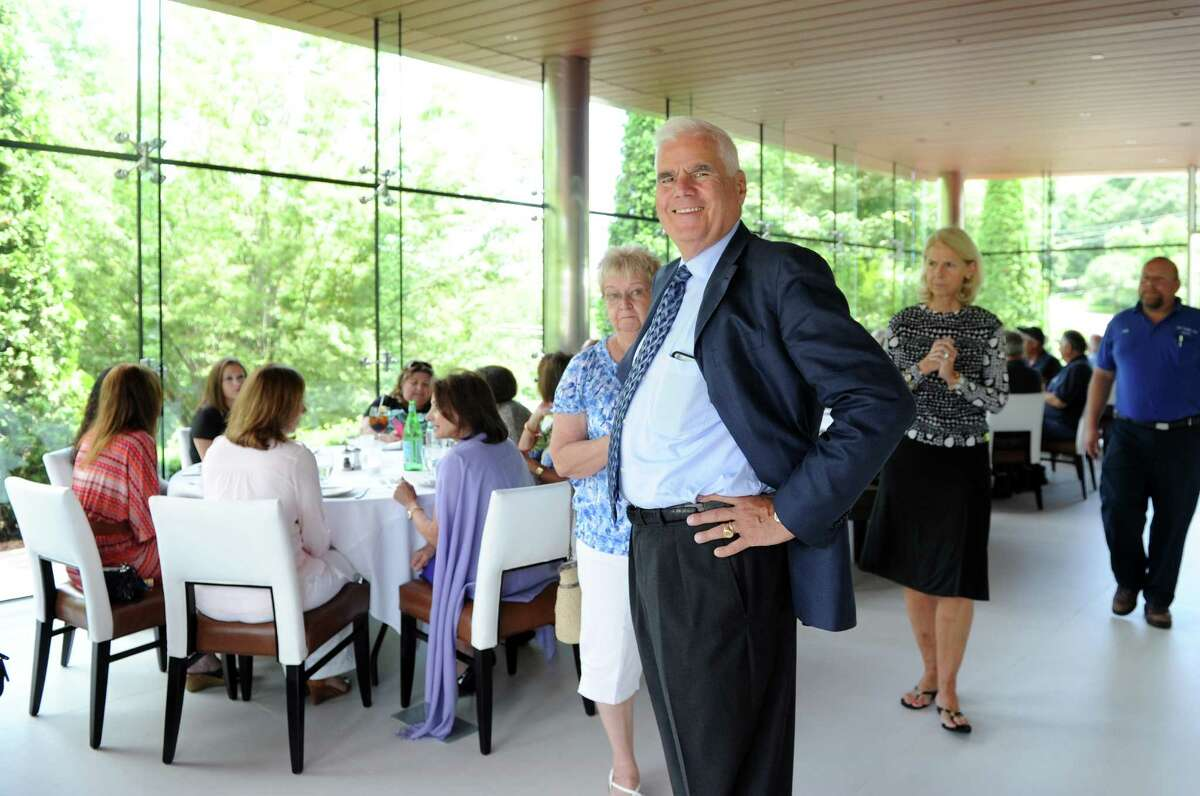 Chairman Bob Scinto, R.D. Scinto, Inc. attends a luncheon for longtime employee Dimas Souza, who is retiring after 26 years, Thursday, July 16, 2015, at Il Palio Ristorante in Shelton, Conn.