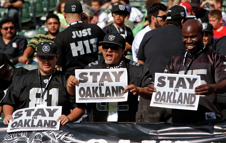 Fans beseech the Raiders with signs before the team played in its preseason game Sunday at O.co Coliseum in Oakland. Photo: Scott Strazzante / The Chronicle / ONLINE_YES