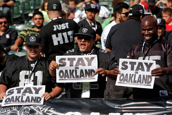 Fans beseech the Raiders with signs before the team played in its preseason game Sunday at O.co Coliseum in Oakland.