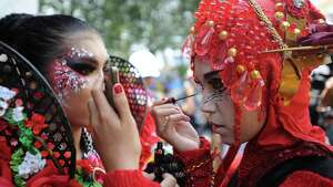 Models prepare backstage during Grand Carnival as part of the 14th Jember Fashion Carnival on August 30, 2015 in Jember, Indonesia. The 14th Jember Fashion Carnival 2015 theme is Outframe and consist of ten parades which include Majapahit, Ikebana, Fossil, Parrot, Circle, Pegasus, Lionfish, Egypt, Melanesia, and Reog. This street carnival is claimed to be one of the biggest in the world and comprises more than 1000 performers parading along 3.6 km of road used as the catwalk.