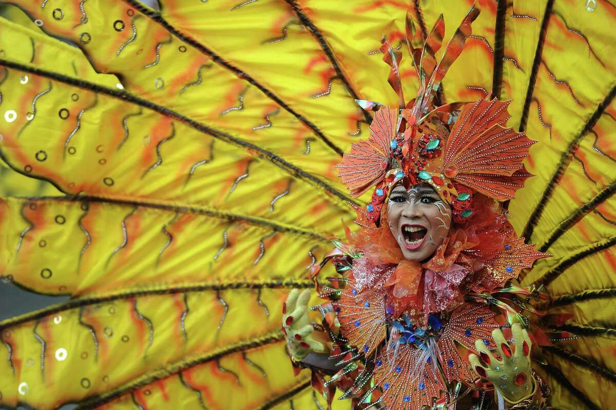 A model wears Lionfish outfit during Grand Carnival as part of the 14th Jember Fashion Carnival on August 30, 2015 in Jember, Indonesia. The 14th Jember Fashion Carnival 2015 theme is Outframe and consist of ten parades which include Majapahit, Ikebana, Fossil, Parrot, Circle, Pegasus, Lionfish, Egypt, Melanesia, and Reog. This street carnival is claimed to be one of the biggest in the world and comprises more than 1000 performers parading along 3.6 km of road used as the catwalk.