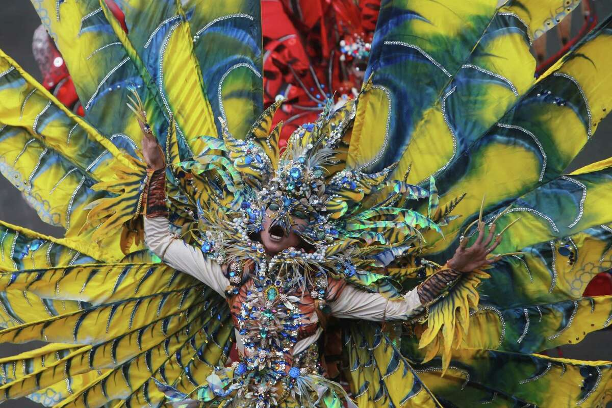 Model shows fashion creations during Grand Carnival as part of the 14th Jember Fashion Carnival on August 30, 2015 in Jember, East Java, Indonesia. The 14th Jember Fashion Carnival 2015 theme is Outframe and consist of ten parades which include Majapahit, Ikebana, Fossil, Parrot, Circle, Pegasus, Lionfish, Egypt, Melanesia, and Reog. This street carnival is claimed to be one of the biggest in the world and comprises more than 1000 performers parading along 3.6 km of road used as the catwalk.