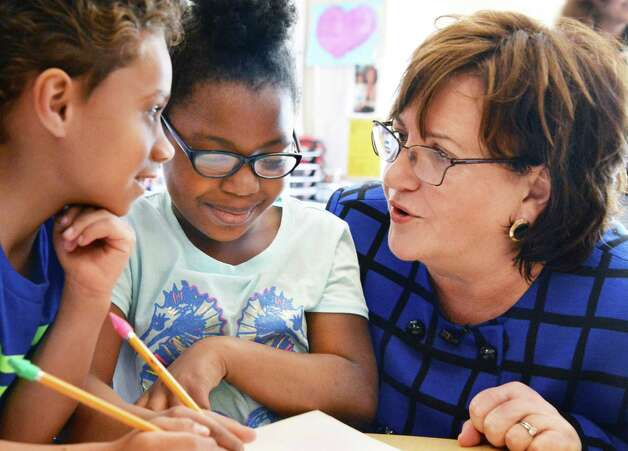 Newly appointed State Education Commissioner Maryellen Elia, right, with first graders Miguel Falu-Garcia, left, and Lashon Fraser during a visit a Pine Hills Elementary School Wednesday, May 27, 2015, in Albany, N.Y.  (John Carl D'Annibale / Times Union) Photo: John Carl D'Annibale / 00032035A