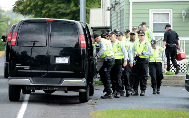 State Police recruits board a transport van after searching for clues in the killing of local hair stylist Jacquelyn Porreca Monday morning, Aug. 31, 2015, in Colonie N.Y. Porreca, 32, was stabbed to death on Aug. 21 inside Recycled Salon on Sand Creek Road. Police said cash was stolen from several places inside the salon. (Will Waldron/Times Union) Photo: WW