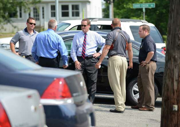 Law enforcement officials gather at the corner of Sand Creek and Russell Roads after State Police recruits searched for clues on a wooded overgrown area off Russell Rd. in the killing of local hair stylist Jacquelyn Porreca Monday morning, Aug. 31, 2015, in Colonie N.Y. Porreca, 32, was stabbed to death on Aug. 21 inside Recycled Salon on Sand Creek Road. Police said cash was stolen from several places inside the salon. (Will Waldron/Times Union) Photo: WW