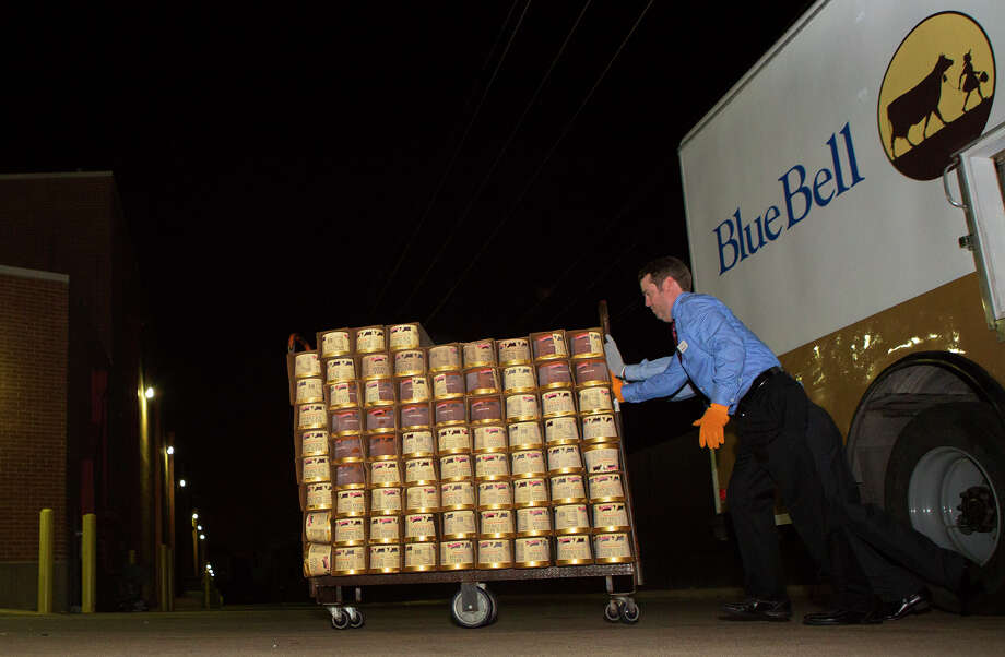 Employees unload a Blue Bell truck carrying fresh ice cream Monday at Randalls in Houston. Photo: Cody Duty /Houston Chronicle / © 2015 Houston Chronicle