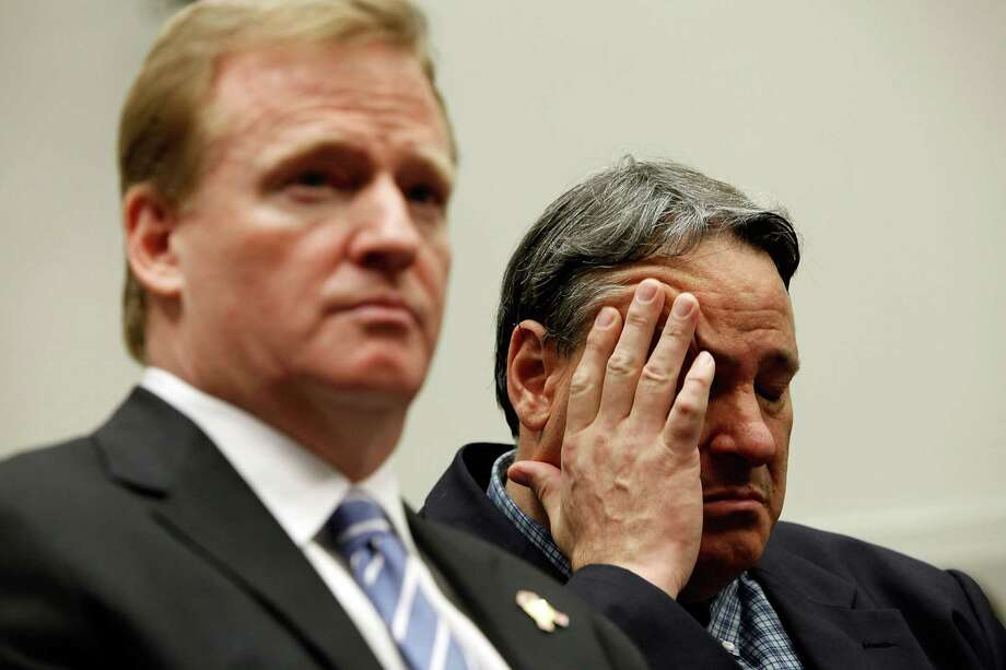 FILE - AUGUST 29: The NFL agreed to settle a lawsuit for $765 million on August 29, 2013 brought by more than 4,500 former players and families of others who have died. The plaintiffs claim their dementia and other health issues resulted from head trauma that occurred while playing in the NFL. WASHINGTON - OCTOBER 28:  Former National Football League player Brent Boyd (R) rubs his head while sitting next to NFL Commissioner Roger Goodell during a hearing of the House Judiciary Committee about football brain injuries on Capitol Hill October 28, 2009 in Washington, DC. A recent study of retired players suggested that N.F.L. retirees ages 60 to 89 are experiencing moderate to severe dementia at several times the national rate. Boyd suffers from headaches, depression, fatigue and dizziness caused by what his doctors diagnosed as post-concussion syndrome.  (Photo by Chip Somodevilla/Getty Images) Photo: Chip Somodevilla, Staff / Getty Images / 2009 Getty Images