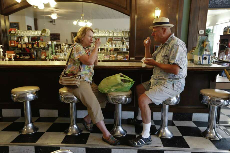 Donna and Jim Hays enjoy their Blue Bell ice cream on Monday at Must Be Heaven in Brenham's town square. Photo: Steve Gonzales, Staff / © 2015 Houston Chronicle