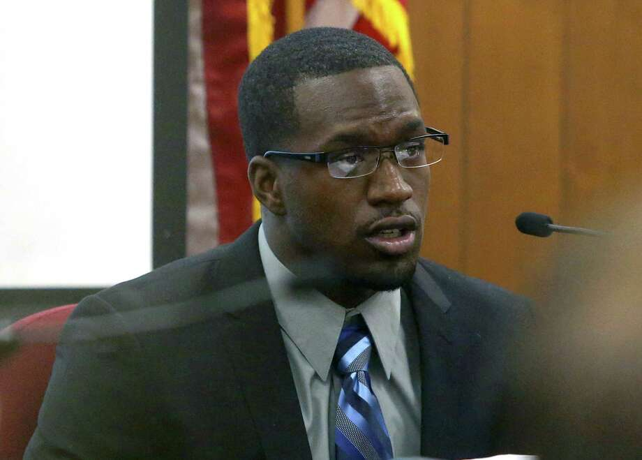 In this photo taken on Thursday, Aug. 20, 2015, Sam Ukwuachu takes the stand during his trial at Waco's 54th State District Court, in Waco, Texas. The one-time All-American who transferred to play football at Baylor University has been convicted of sexually assaulting a fellow student athlete in 2013.  (Jerry Larson/Waco Tribune-Herald via AP) MANDATORY CREDIT ORG XMIT: TXWAC201 Photo: Jerry Larson / Waco Tribune Herald
