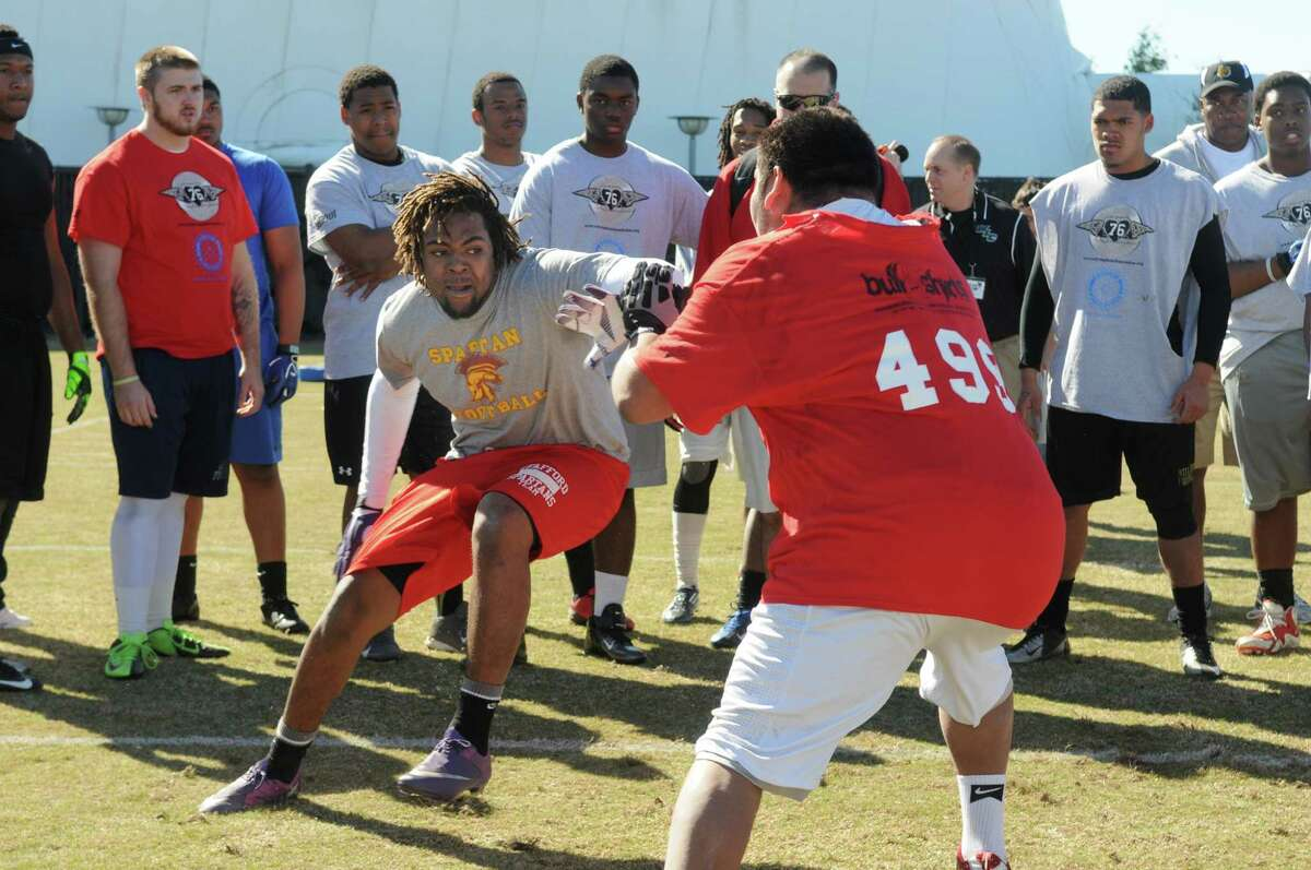 Nate Endsley, left, a linebacker/defensive end from Stafford High School, works against Juan Olivo, an offensive/defensive lineman from South Houston High School, during the 6th Annual Greater Houston Senior Football Showcase at the Methodist Training center at Reliant Stadium on Saturday.