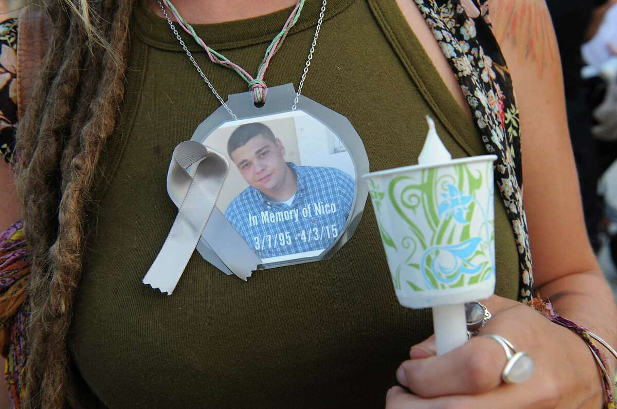 Makenzie McAvinney of Lake George holds a candle for her friend Nico Scroggy during an overdose awareness candlelight vigil at the Spirit of Life Fountain in Congress Park on Monday, Aug. 31, 2015 in Saratoga Springs, N.Y. The concern of rising heroin related deaths were especially addressed. (Lori Van Buren / Times Union)