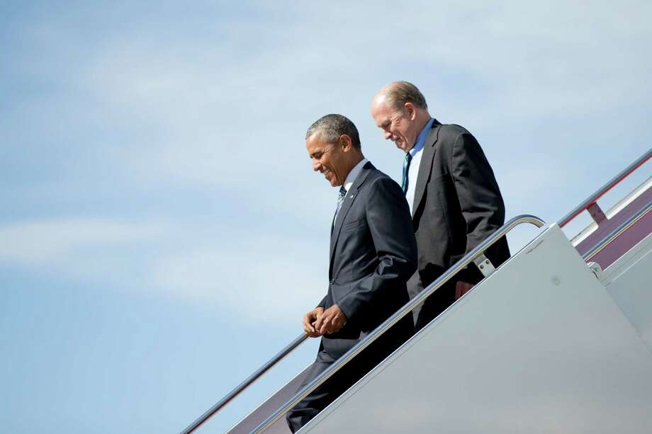 President Barack Obama, accompanied by Alaska Gov. Bill Walker, steps off Air Force One after arriving at Elmendorf Air Force Base, Monday, Aug. 31, 2015, in Anchorage, Alaska. President Barack Obama opens a historic three-day trip to Alaska aimed at showing solidarity with a state often overlooked by Washington, while using its glorious but changing landscape as an urgent call to action on climate change. (AP Photo/Andrew Harnik) ORG XMIT: AKAH107 Photo: Andrew Harnik / AP