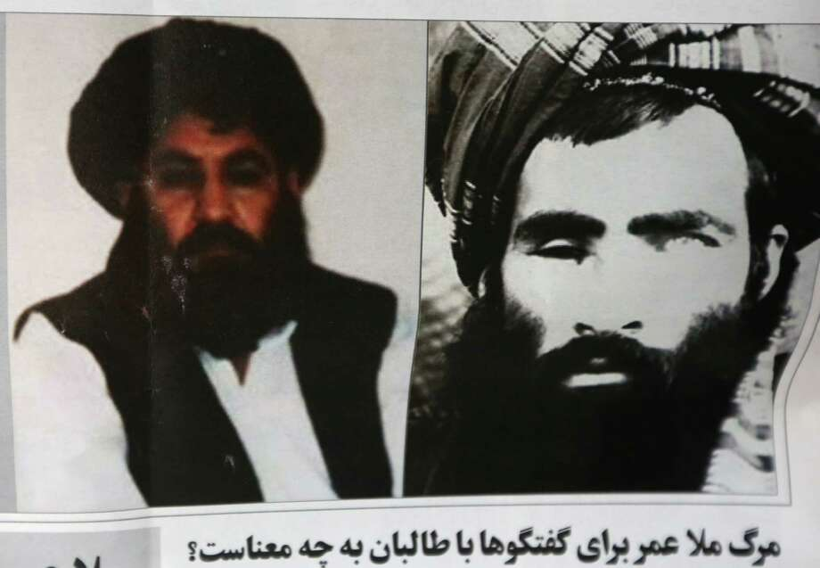 In this Aug. 1 photo, an Afghan newspaper features pictures of the new leader of the Afghan Taliban, Mullah Akhtar Mansoor, left, and former leader Mullah Mohammad Omar, in Kabul, Afghanistan following the announcement of the death of one-eyed figurehead Omar. Photo: Rahmat Gul / AP