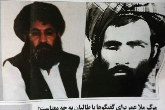 FILE - In this Saturday, Aug. 1, 2015 file photo, an Afghan newspaper headlines pictures of the new leader of the Afghan Taliban, Mullah Akhtar Mansoor, left, and former leader Mullah Mohammad Omar, in Kabul, Afghanistan. Defying the fury of Afghanistan's government and warnings from Washington, Pakistani authorities appear to be turning a blind eye to a meeting of hundreds of Taliban followers in Quetta, Pakistan, near the Afghan border, aimed at resolving a dispute over the group's leadership following the announcement of the death of one-eyed figurehead Mullah Mohammad Omar. (AP Photo/Rahmat Gul, File) ORG XMIT: CAITH101