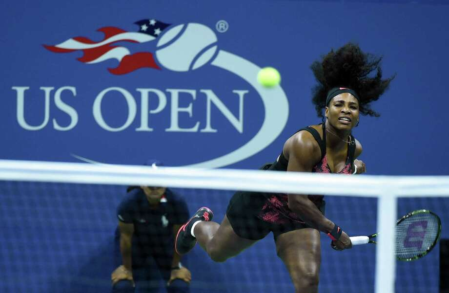 Serena Williams of the US serves the ball to Vitalia Diatchenko of Russia during their Womens Singles Round 1 match at the 2015 US Open at USTA Billie Jean King National Tennis Center in New York on August 31, 2015. AFP PHOTO/JEWEL SAMADJEWEL SAMAD/AFP/Getty Images ORG XMIT: 554354469 Photo: JEWEL SAMAD / AFP