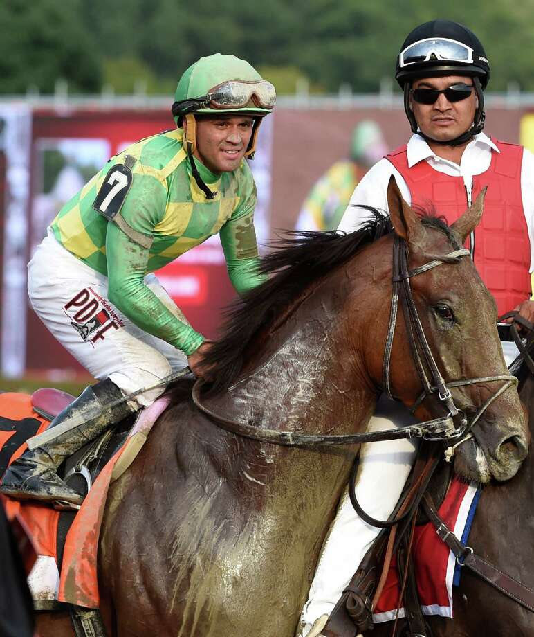 Jockey Javier Castellano, is all smiles aboard Keen Ice after winning 146th running of the Travers Stakes Saturday evening Aug. 29, 2015 at the Saratoga Race Course in Saratoga Springs, N.Y.    (Skip Dickstein/Times Union) Photo: SKIP DICKSTEIN / 00033110A